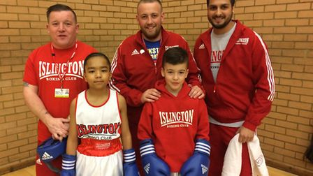 Islington Boxing Club juniors Oscar Spencer-Gittens and Sonny Devine (front) with coaches (left to r