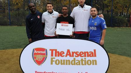 A visit to the team by Per Mertesacker and Mesut Ozil of Arsenal
