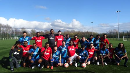 The Freedom From Torture team with a similar refugee therapy group team from Manchester United