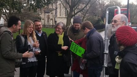 Sian Berry and Islington residents during the installation of the pollution measuring devices one mo