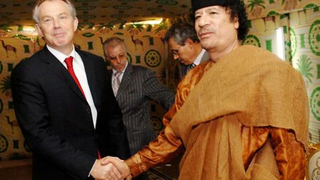 Former Prime Minister Tony Blair meeting the then Libyan leader Colonel Muammar Gaddafi. Picture: PA