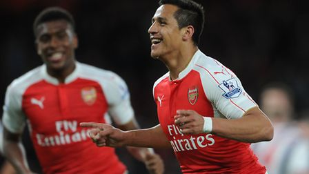 Alexis Sanchez celebrates scoring his and Arsenal's 2nd against West Brom (Photo by David Price/Arse