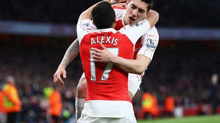 Alexis Sanchez of Arsenal celebrates with Hector Bellerin (Photo by Paul Gilham/Getty Images)
