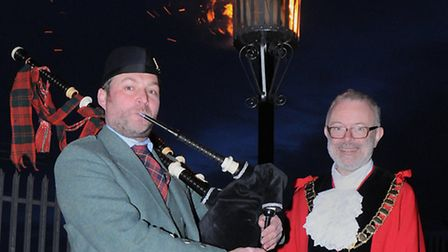 A bagpiper played at the ceremony to mark the Queen's 90th birthday where Cllr Richard Greening (R)