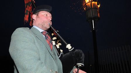 A bagpiper played the national anthem after the beacon was lit