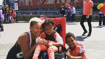 Bailey in her buggy with her mother Mel and brother Shea