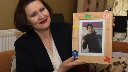 Leo Andrade holding a picture of her autistic son.She's helped start a campaign launched by mothers