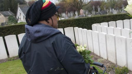 Sheona Josiah looks over the grave of L-Cpl Constantine Morris in Islington and Camden Cemetery. Pic