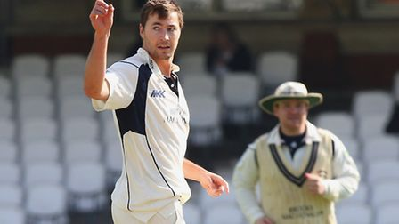 James Fuller of Middlesex claims the wicket of Surrey's Dominic Sibley during their pre-season frien