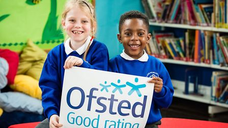 Moreland Primary School pupils Sydney Herbert, aged seven, and Kyan Rowe, six, celebrate the school'