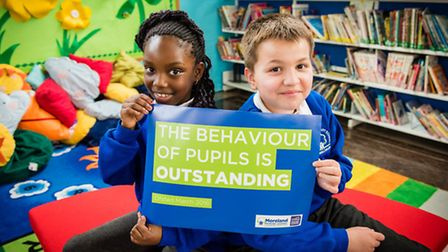 Moreland Primary School pupils Sarah Osagie, aged seven, and Leo Spinola, 10, celebrate the school's