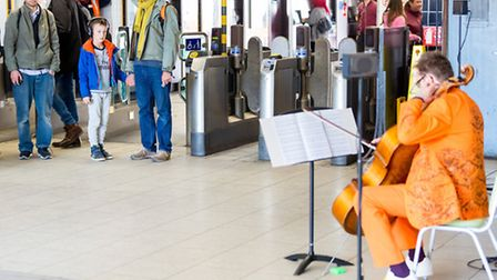 Tim Gill performing at Highbury & Islington station yesterday. Picture: Benedict Johnson