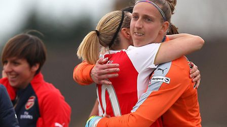 Arsenal goalkeeper Sari van Veenendaal (right) celebrates with Kelly Smith after her vital saves in