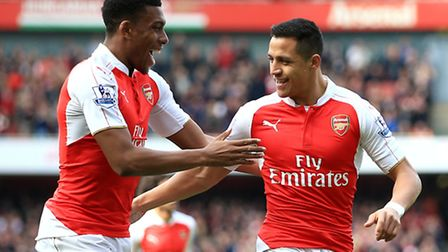 Arsenal's Alexis Sanchez (right) celebrates with team-mate Alex Iwobi after scoring his side's first