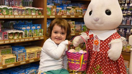 The Easter display at the Sylvanian Families shop in Highbury. Orla, aged 2 has some fun with the di
