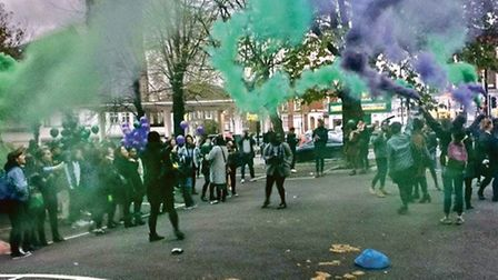 Protesters set off purple and green smoke flares (Picture: Jade Jackman)