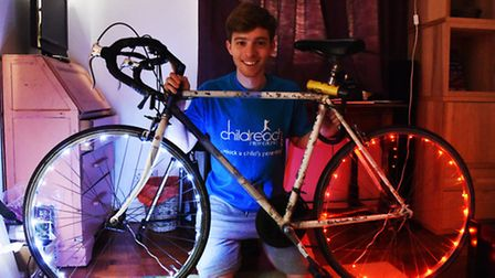 'Christmas lights': 22-year-old Merlin Bruce with his LED bike lights (Picture: Ken Mears)
