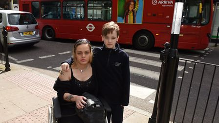 Rebecca with son Chae, 10, by the crossing on the corner of Hazellville Road and Hornsey Road where