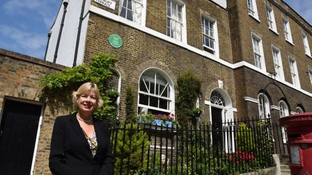 Bev Ronalds outside 1, Highbury Terrace, where her great-great-great uncle Sir Francis Ronalds dabbl