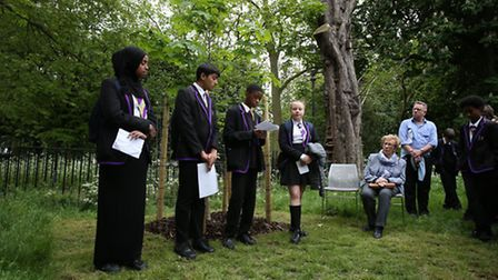 Dr. Eva Schloss watches on as children from Highbury Fields School read extracts from Anne Frank's d