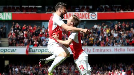 Arsenal's Olivier Giroud celebrates with Nacho Monreal after scoring the opening goal against Aston