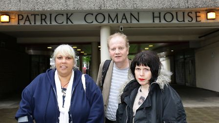 Patrick Coman House residents Alma Belai, Phil Cosgrove and Sarah Nash outside their tower block. Pi