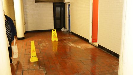 Hazard warning signs at the block's communal entrance. Picture: Steve Poston
