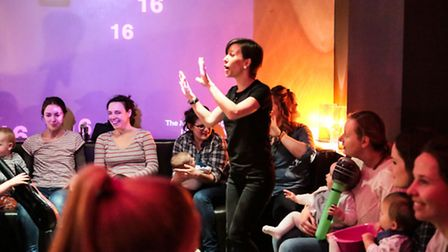Emily Garsin, co founder of Starling Arts, leads a singing session
