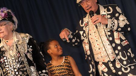 Student Blessing Ntumba sings 'Maybe it's because I'm a Londoner' with a pearly king and queen