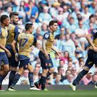Arsenal's Olivier Giroud (3rd left) celebrates scoring his side's first goal (Tim Goode/PA Wire)