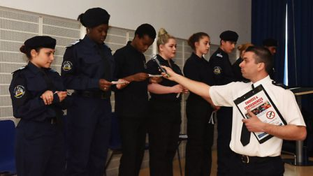Police cadet youth volunteers were asked by Sgt Marcel Baker to read out the names of the 15 teenage