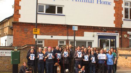 The Mayhew team outside the charity's building in Kensal Green