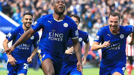 Leicester City's Wes Morgan (centre) celebrates after scoring against Manchester United