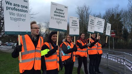 Dr David Antcliffe, far left, on the picket line with fellow junior doctor strikers at Northwick Par