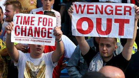 Arsenal fans protest after the 2-2 draw at the Etihad Stadium