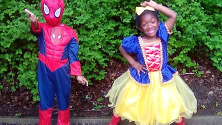 Aaron, four, and Annalise, three, in their favourite superheroes outfits