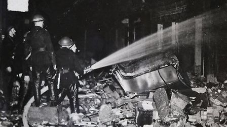 Jack pictured fighting a fire during the Blitz