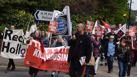 Protestors marching on Holloway Prison to demand the prison site is replaced by council housing and