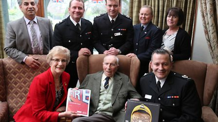 Jack and his daughter Pamela, bottom left, with representatives from the Fire Service