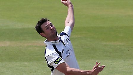 Middlesex's James Franklin bowling.