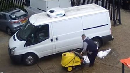 The CCTV captures the thief taking the steam cleaner to the car