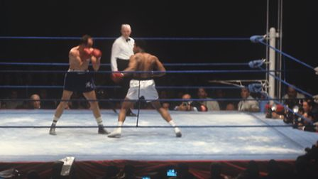 Mohammad Ali (Cassius Clay) and Henry Cooper during their fight for the world heavyweight title -- r