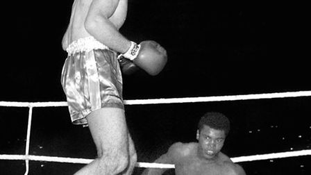 Henry Cooper and Cassius Clay, now Muhammad Ali during their fight at Wembley in 1963