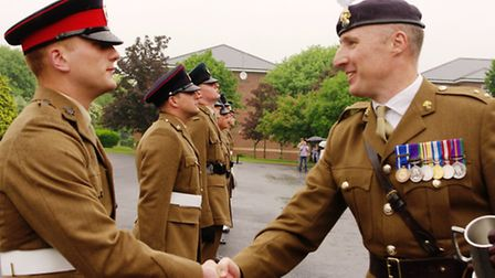 Daniel being congratulated on his award by Lieutenant Colonel Tony Gawthorpe, the inspecting office