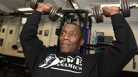 Bodybuilder Ian Dowe works out at his gym