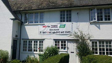 Campaigners in Roe Green Village have been told to take down their banners