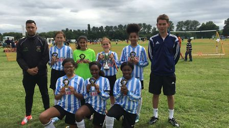 Brent Under-12 girls with their trophy