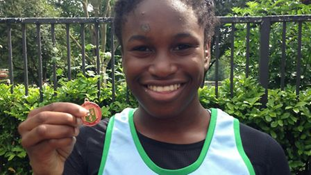 Islington sprinter Shania Umah with one of her medals at the London Schools Championships