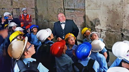A Winston Churchill look-a-like takes the children on a tour of the former Cabinet War Rooms in Doll