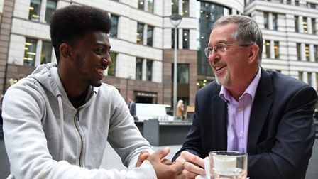 Mentor Jeremy Cornish on the right talking to Filmon outside the Gherkin